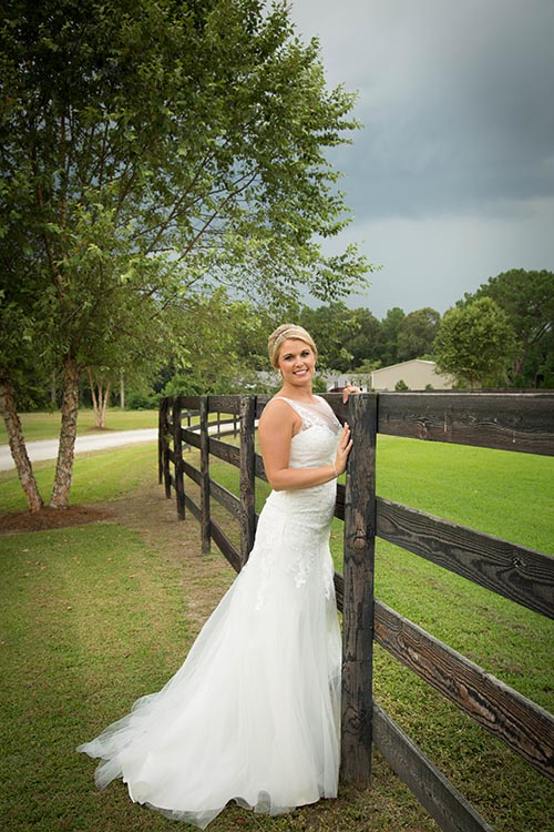 Bride Poses by Equestrian Fencing