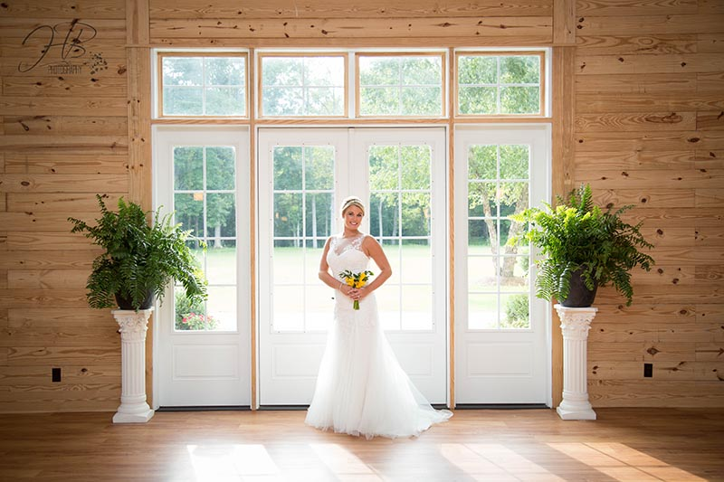 Bride Poses at Side entry doors