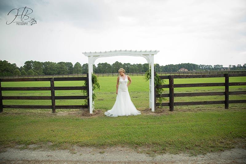 Bride Posing Under Arch Way