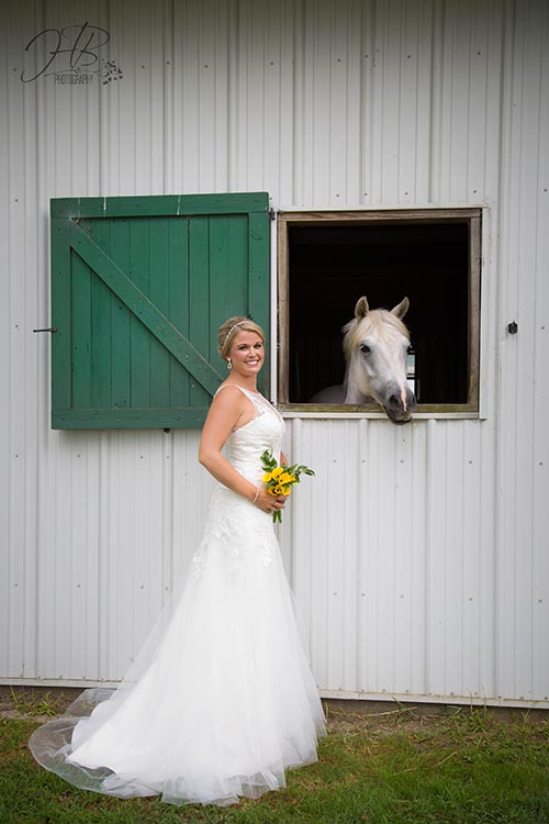 Bride poses with white horse at FHF Venue