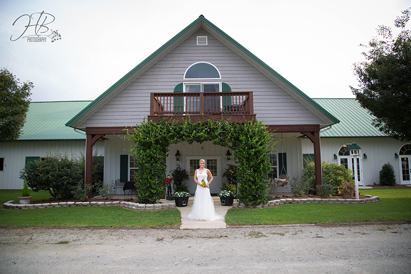 Bride poses in front of main entrance to FHF Venue