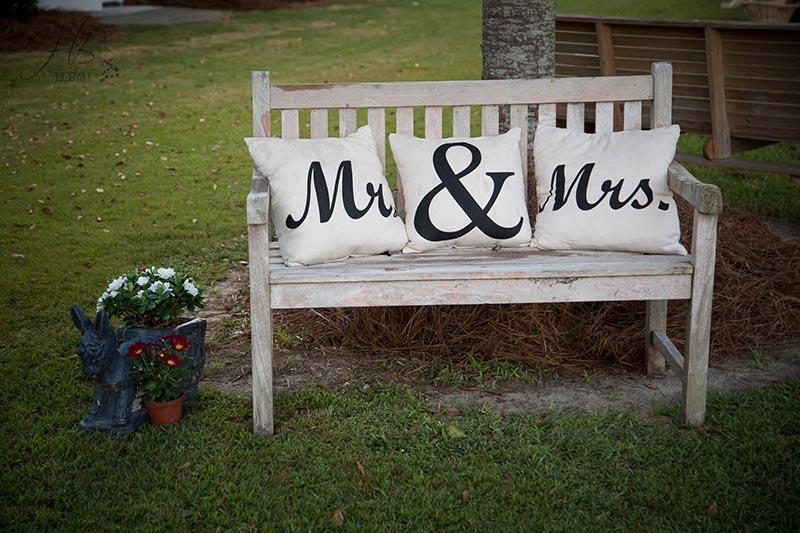 Mr. & Mrs. Pillows on White Bench