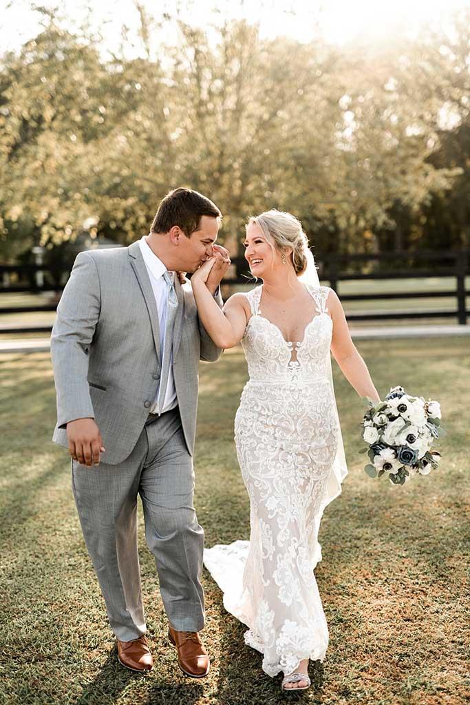 groom-kissing-brides-hand